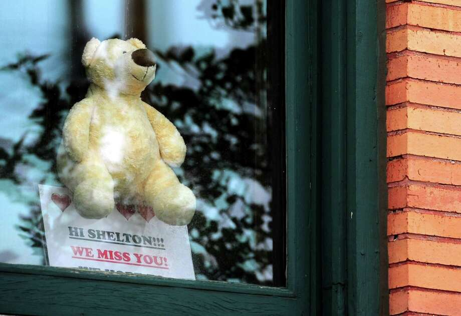 A plush toy bear sits in the window at Plumb Memorial Library in Shelton, Conn., on Wednesday Apr. 8, 2020. Photo: Christian Abraham / Hearst Connecticut Media / Connecticut Post