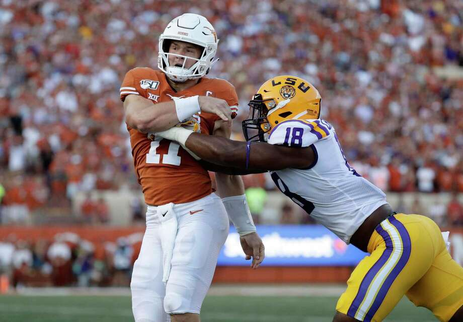 Laredo Morning Times managing editor Zach Davis predicts the Cowboys will select LSU edge rusher K'Lavon Chaisson with the No. 17 overall selection Thursday in the NFL draft. Photo: Eric Gay /Associated Press File / Copyright 2020 The Associated Press. All rights reserved.
