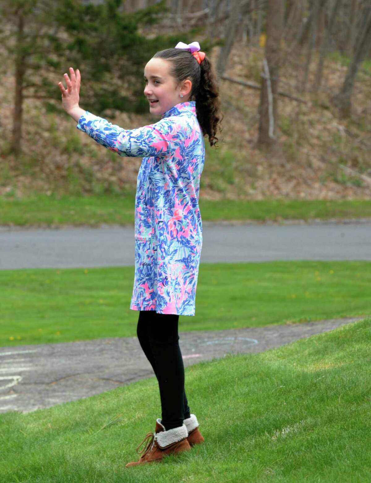 Aubrey Lewis got a parade of fire trucks, police cars and family friends past her house to help her celebrate turning 10. Thursday, April 23, 2020, in Bethel, Conn. The Stony Hill Fire Department is helping kids celebrate their birthdays during the coronavirus isolation.