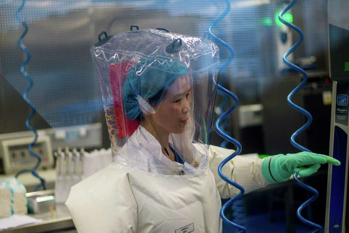 (FILES) This file photo taken on February 23, 2017 shows a worker inside the P4 laboratory in Wuhan, capital of China's Hubei province. - The P4 epidemiological laboratory was built in co-operation with French bio-industrial firm Institut Merieux and the Chinese Academy of Sciences. The facility is among a handful of labs around the world cleared to handle Class 4 pathogens (P4) - dangerous viruses that pose a high risk of person-to-person transmission. (Photo by JOHANNES EISELE / AFP) (Photo by JOHANNES EISELE/AFP via Getty Images)