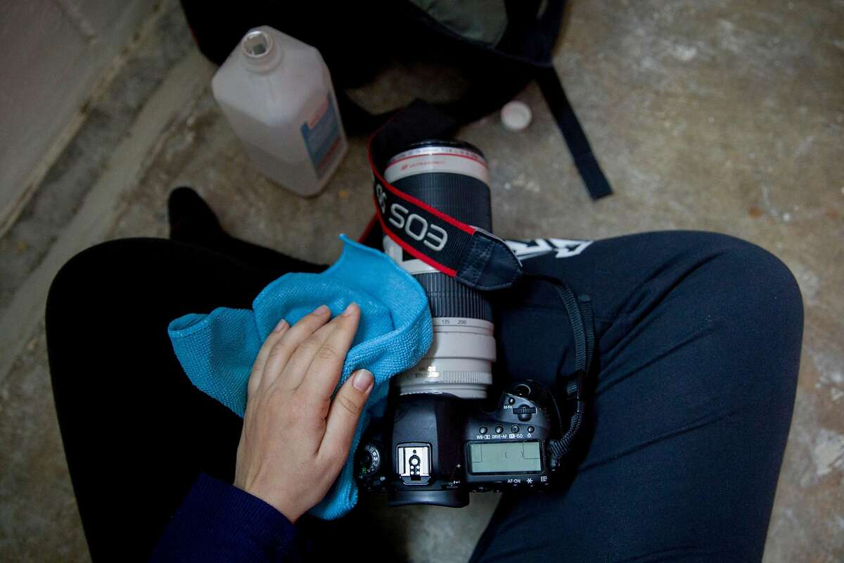 In my home sweatpants, disinfecting my gear with a rag and rubbing alcohol in the downstairs space at my apartment in Oakland, Calif. Tuesday, March 17, 2020.