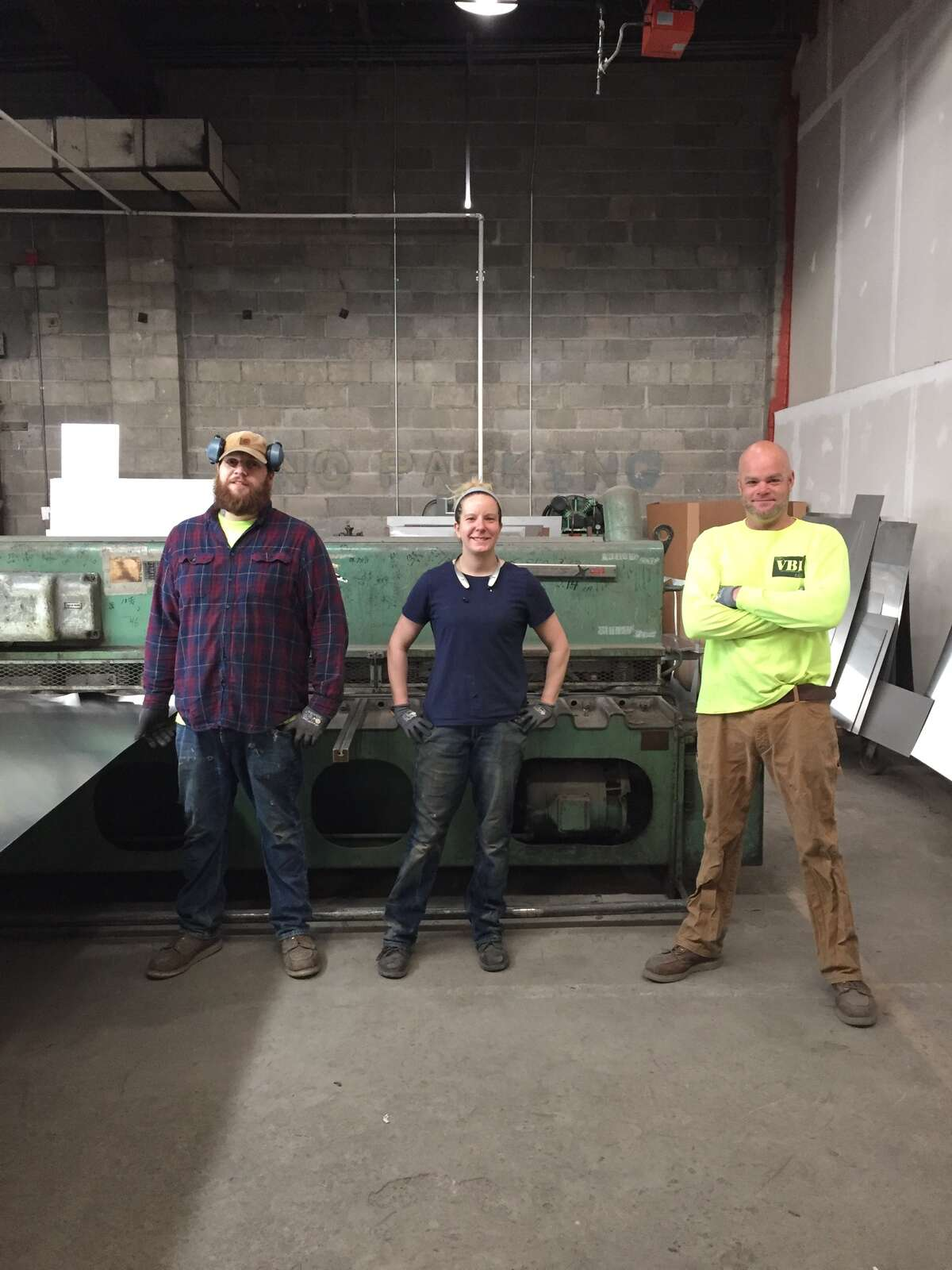 Workers at VBI in Scotia turning aluminum sheets into strips for face masks: L-R, Justin Taylor, Holly Bader, Pete McDermott.