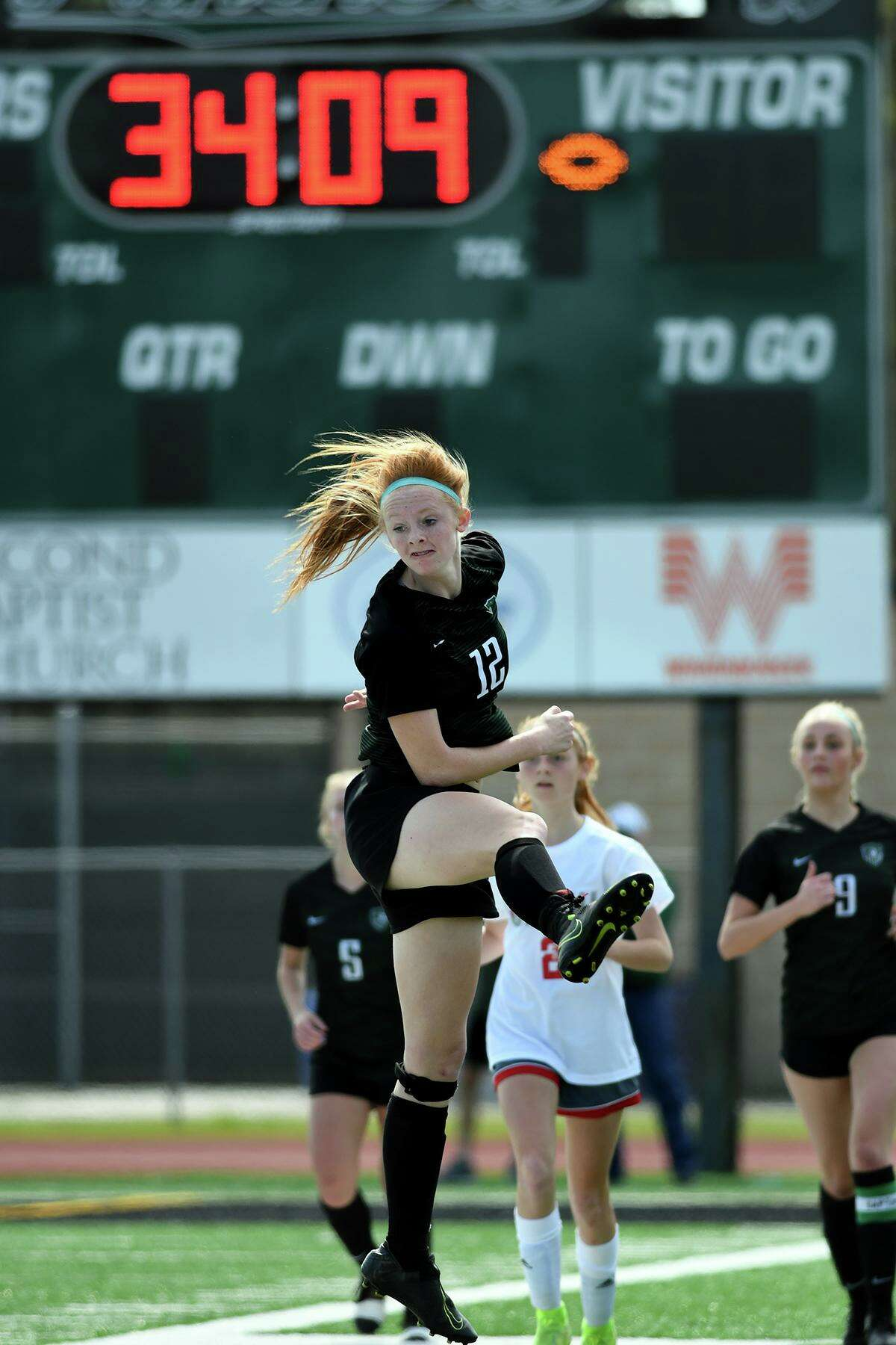 Kingwood Park freshman forward Emma Yeager follows the ball upfield after making a play against Tomball during their District 20-5A matchup at KPHS on Feb. 29, 2020.