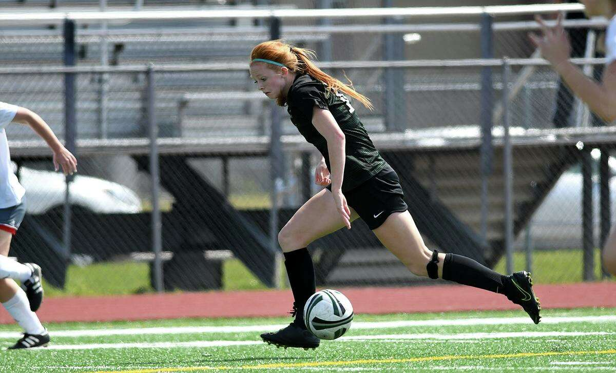 Kingwood Park freshman forward Emma Yeager works the ball upfield against Tomball during their District 20-5A matchup at KPHS on Feb. 29, 2020.
