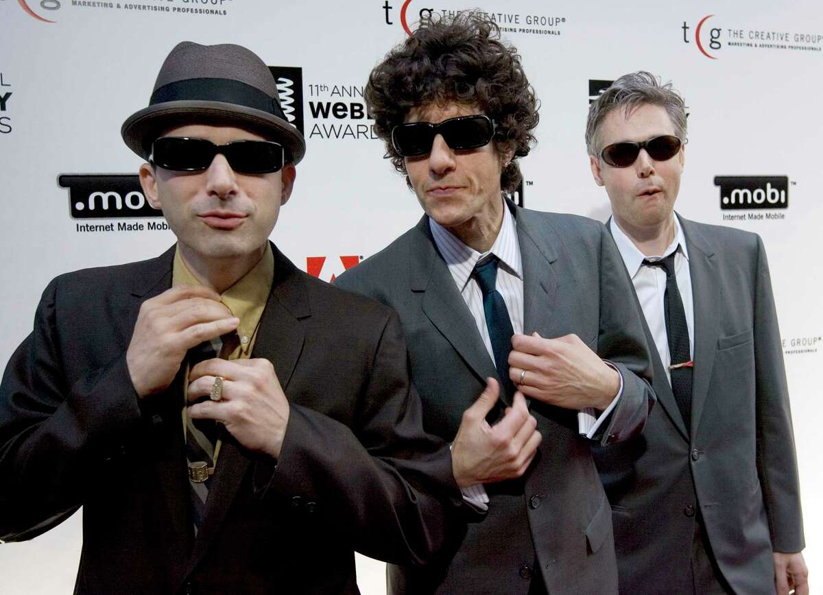 """FILE - This June 5, 2007 file photo shows The Beastie Boys, from left, Adam a€œAd-Rock"""" Horovitz, from left, Mike a€œMike D"""" Diamond and Adam a€œMCAa€ Yauch at the 11th Annual Webby Awards in New York. The new documentary """"Beastie Boys Story,"""" directed by longtime collaborator and friend Spike Jonze, debuts Friday on Apple TV Plus. (AP Photo/Stephen Chernin, File)"""