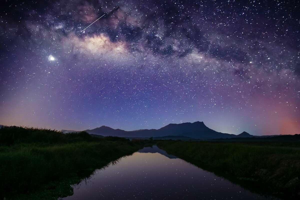 Milky way over Mount Kinabalu. View from irrigation canal at Sangkir, Kota Belud, Sabah.