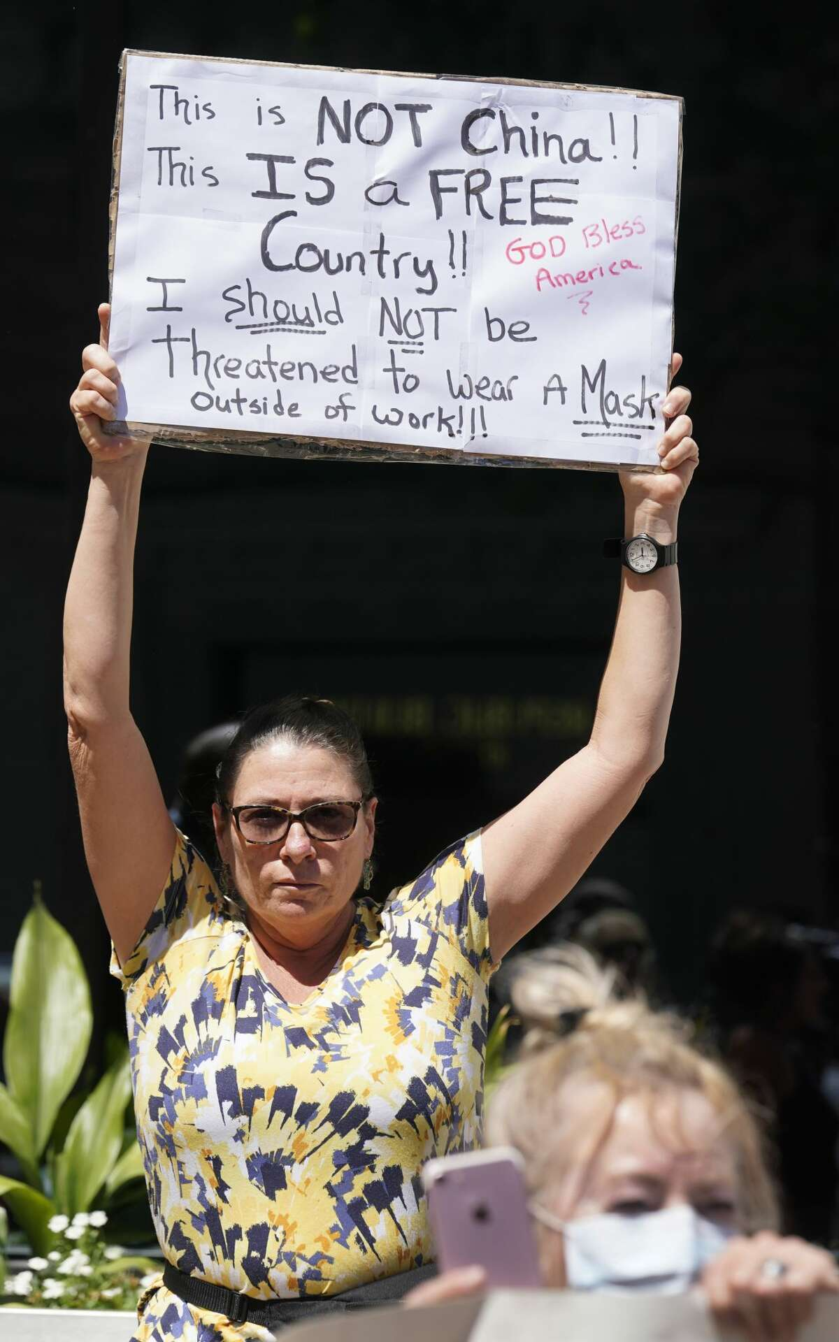 People protest outside the Harris County offices, 1001 Preston, Thursday, April 23, 2020 in Houston during a rally organized by Steven Hotze, a Republican activist, against the order to wear masks. Harris County Judge Lina Hidalgo ordered residents to cover their nose and mouth while in public effective Monday for 30 days amid the Covid-19 pandemic.
