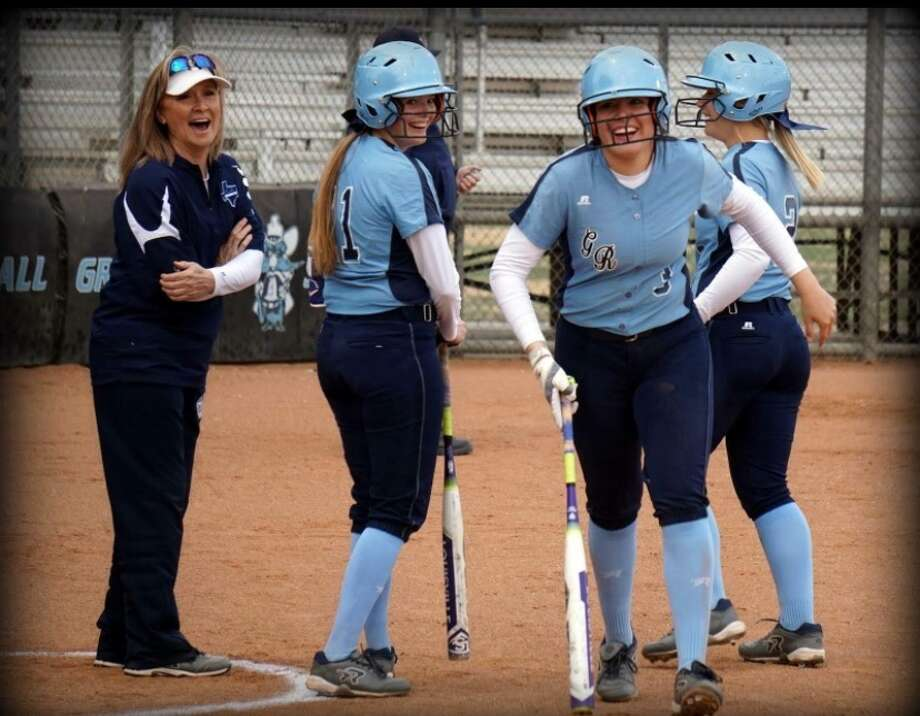 Greenwood softball coach Lee Anne Curry, left, laughs with her players in this undated photo. Courtesy photo