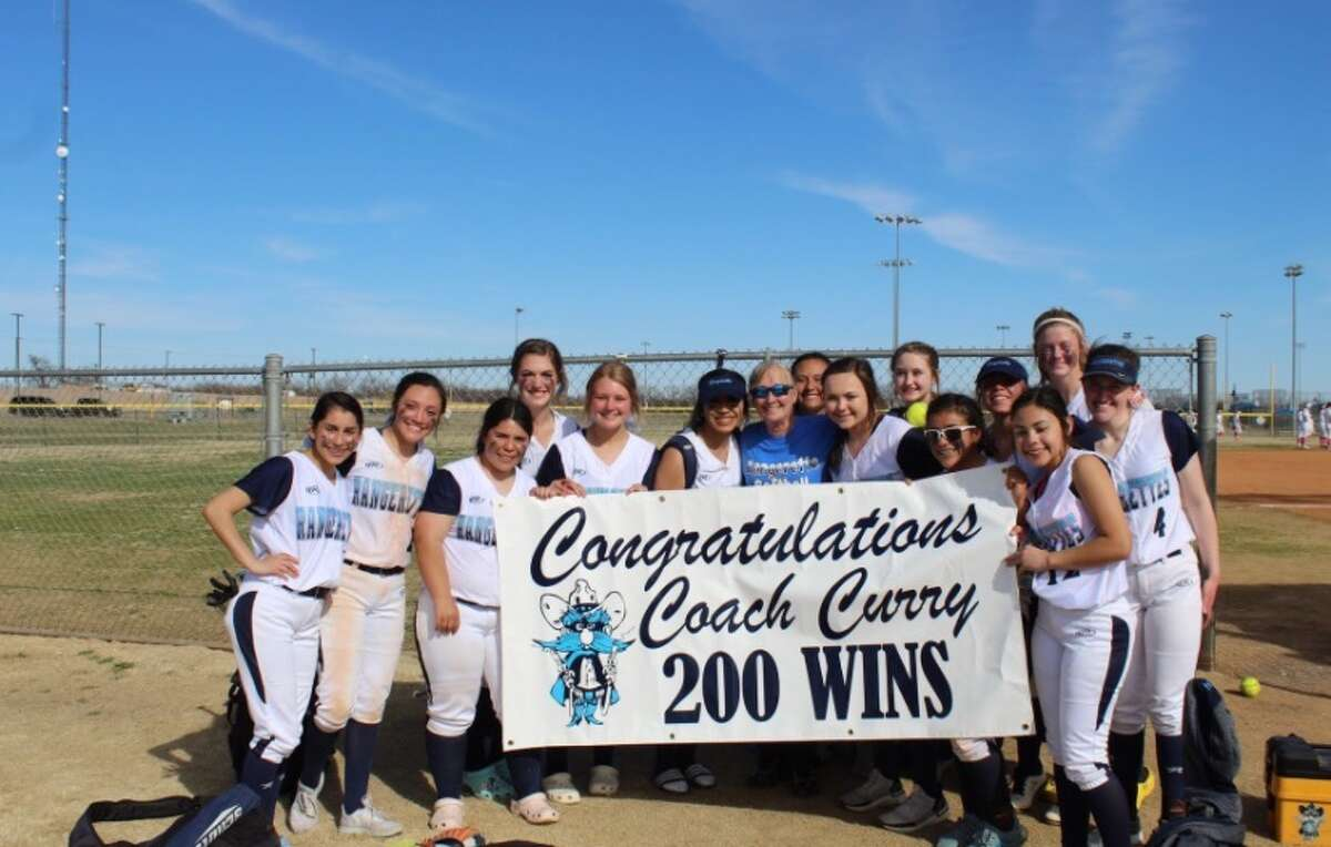 Greenwood softball coach Lee Anne Curry takes a team picture with her players after the Rangerettes beat Kermit, 11-7, to register her 200th career victory as head coach on Feb. 28 in San Angelo. Courtesy photo