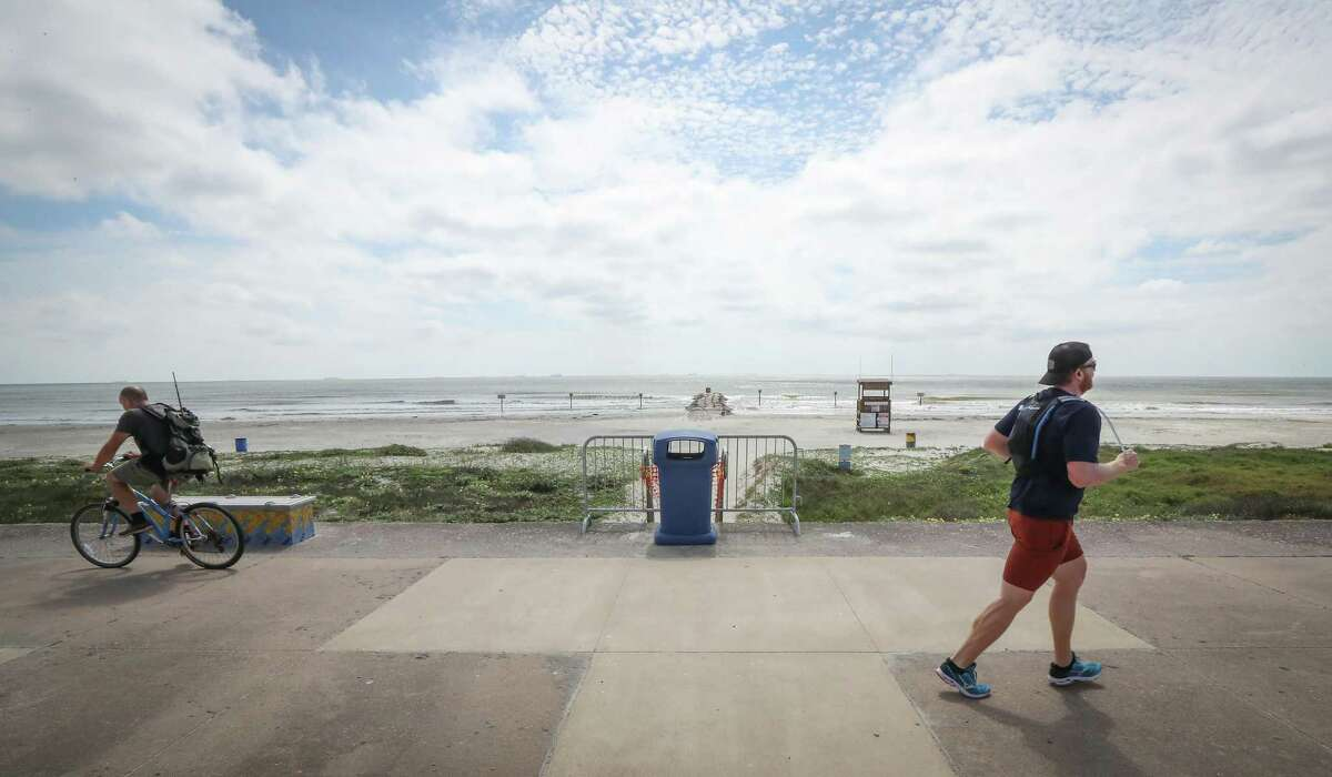 People still enjoyed the seawall after Galveston ordered their beaches closed Tuesday, March 31, 2020, in Galveston. The city of Galveston will partially reopen public beaches on April 27, 2020 after closing them for nearly a month due to the novel coronavirus outbreak.