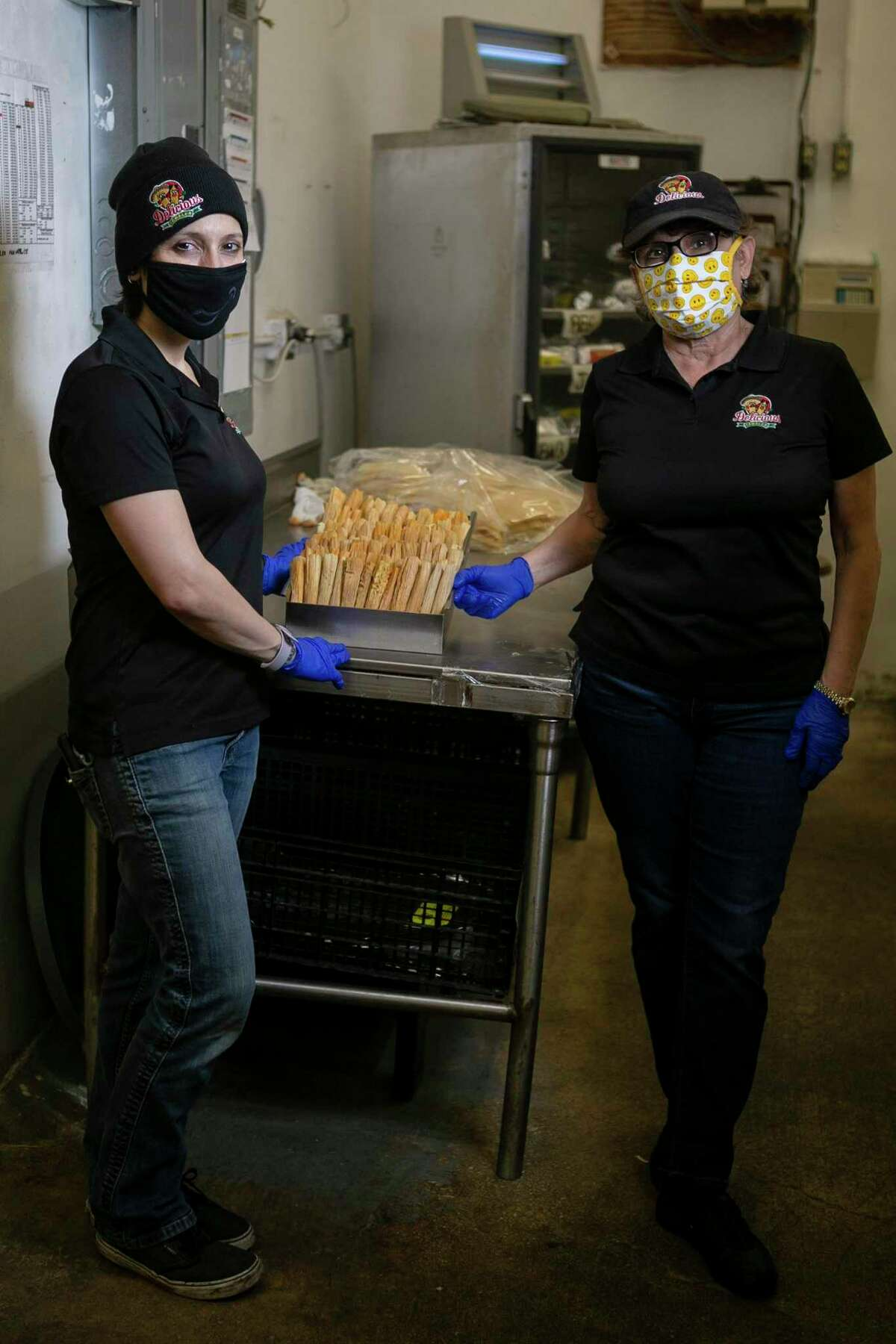 Herlinda Lopez-Wood, left, and Valerie Gonzalez-Handly, right, at Delicious Tamales' Culebra Road location in San Antonio. The business obtained a $232,000 loan through the Bank of San Antonio as part of the Paycheck Protection Program.