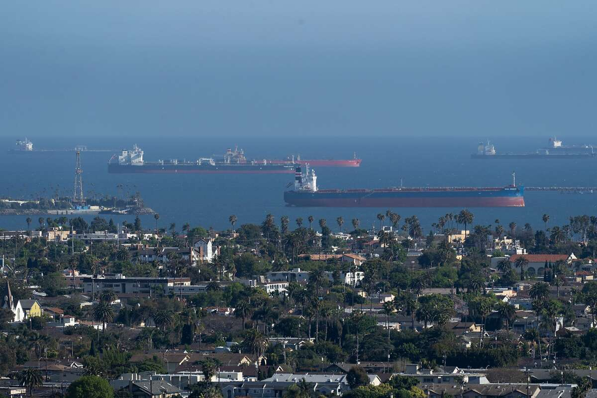 Oil tankers sit anchored off the coast of Long Beach, California, U.S., on Tuesday, April 21, 2020. Almost three dozen ships -- scattered in waters from Long Beach to the San Francisco Bay -- are mostly acting as floating storage for oil that's going unused as the coronavirus pandemic shutters businesses and takes drivers off the road. Photographer: Bing Guan/Bloomberg