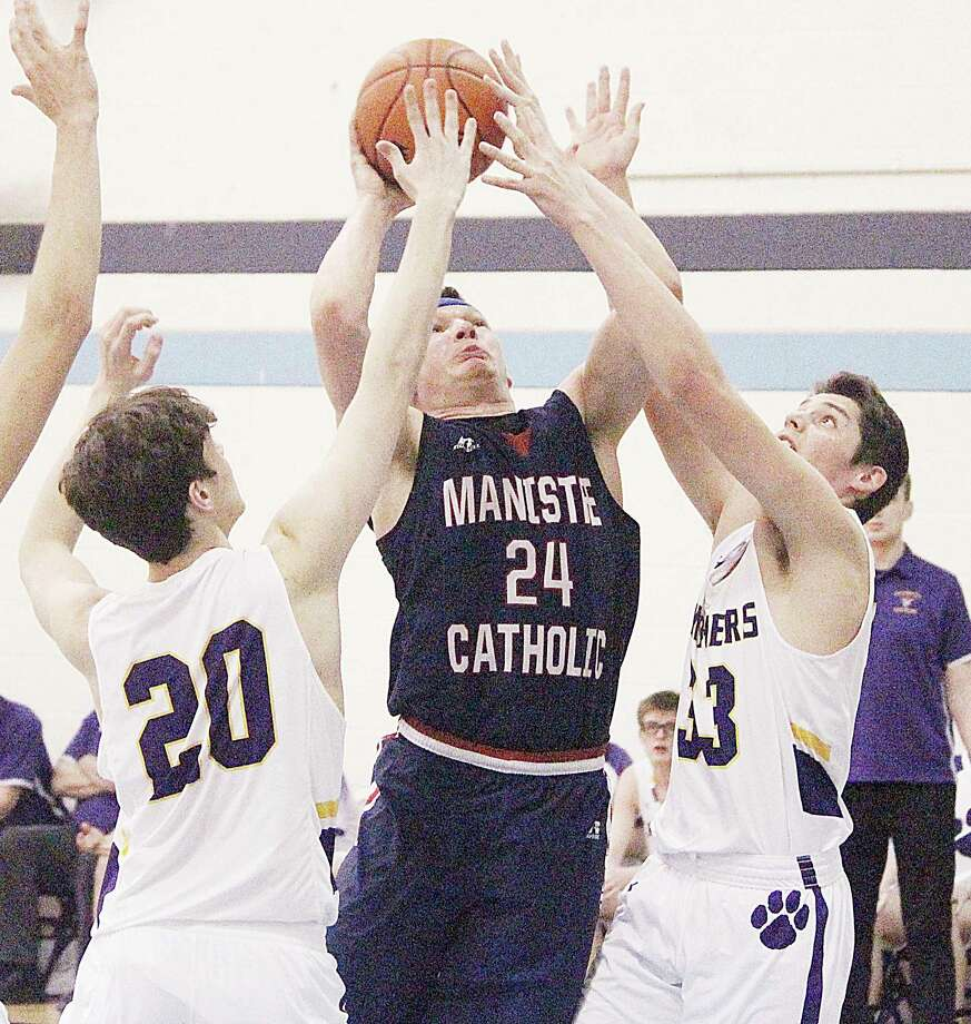Manistee Catholic Central's Kyle Mikolajczak was named among the state's best Division 4 basketball players by the Basketball Coaches Association of Michigan. (News Advocate file photo)