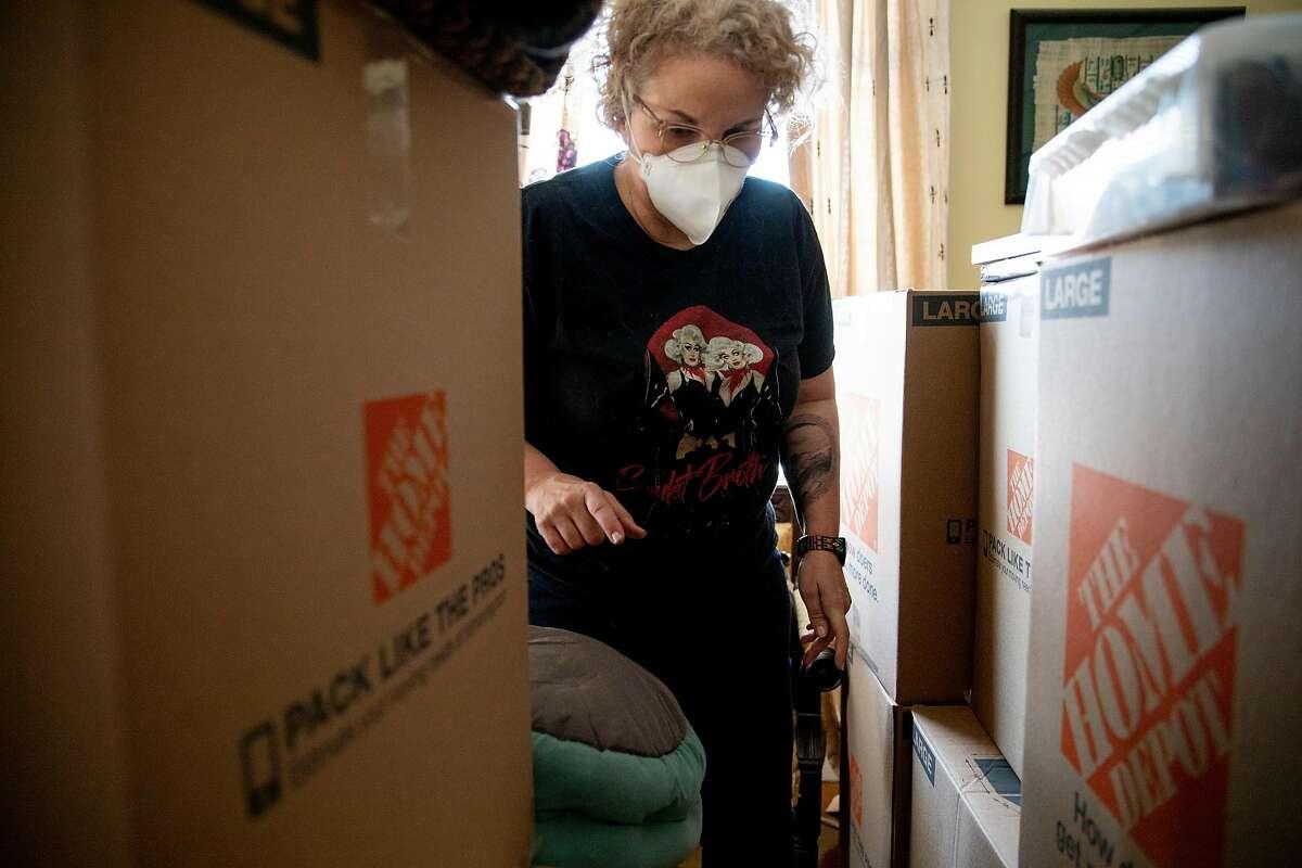 Kristin Demoro packs up belongings at her apartment in Oakland.