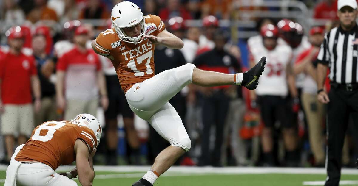 Cameron Dicker #17 of the Texas Longhorns kicks a field goal in the first quarter against the Utah Utes during the Valero Alamo Bowl at the Alamodome on December 31, 2019 in San Antonio, Texas. (Photo by Tim Warner/Getty Images)