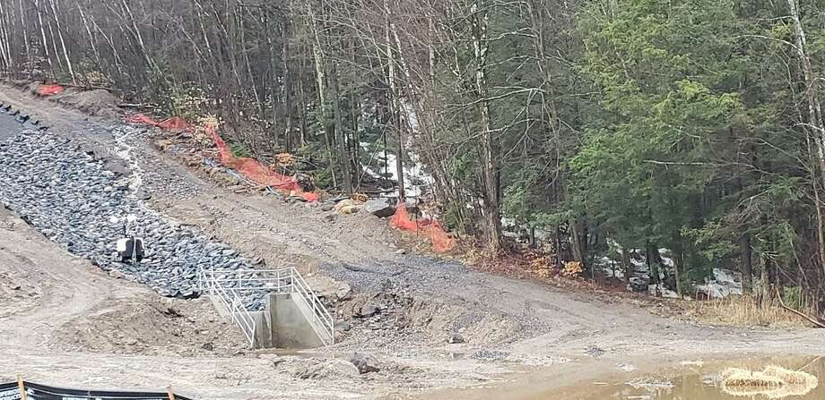 Last week's heavy rainfall impacted the rebuilding project of the Sucker Brook Dam, with runoff and silt flowing into a small cove off the main area of Highland Lake. The project, under the auspices of the DEEP, involves rebuilding the dam after the first project failed nearly two years ago. Above, a view of the lower portion of the dam project. Photo: Contributed Photos /