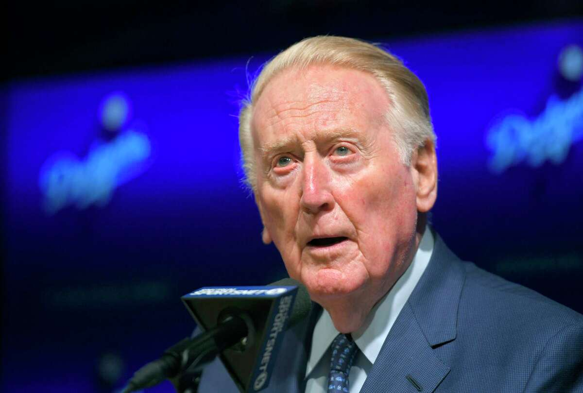 """FILE - In this May 3, 2017 file photo, Hall of Fame broadcaster Vin Scully speaks to reporters about being inducted into the Los Angeles Dodgers Ring of Honor prior to a baseball game between the Dodgers and the San Francisco Giants in Los Angeles. Scully, 92, took a fall in his home Tuesday, April 21, 2020, and was taken to the hospital, where he was """"resting comfortably,"""" the Dodgers announced Thursday, April 23. (AP Photo/Mark J. Terrill, File)"""