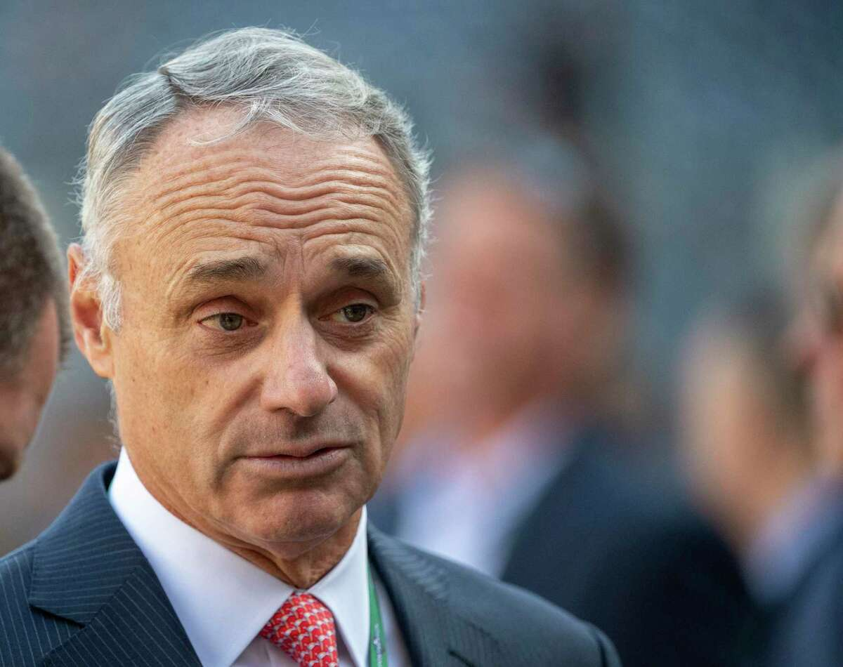 Commissioner Rob Manfred deemed the Red Sox's sign-stealing worthy of no more than the suspension of a low-level employee and the forfeiture of a single second-round draft pick. Boston manager Alex Cora's yearlong suspension was related to his tenure with the Astros.