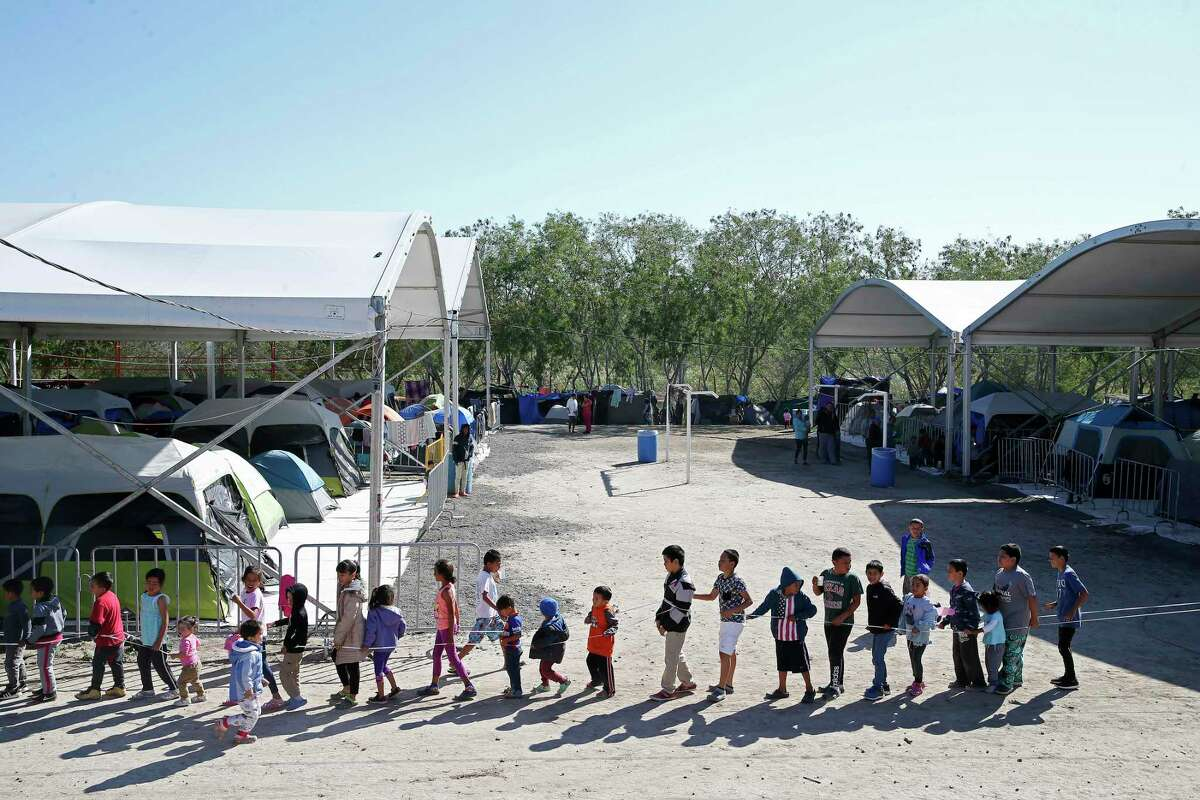 Children play games at the camp, which formed last summer after the U.S. implemented the Migrant Protection Protocol, also known as Return to Mexico program. Migrants were sent back to Mexico to await their immigration court date.