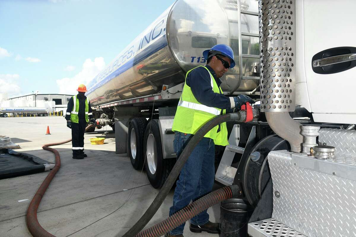 Matthew Aguilar, right, Trainer Manager, works with Walker Evans, left, from Dallas, on a simulated fuel delivery at Sun Coast Resources in Houston on May 25, 2018. (Jerry Baker/For the Chronicle)