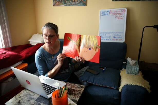 Leanne Francis, first grade teacher at Harvey Milk Civil Rights Academy, conducts an online class from her living room on March 20, 2020 in San Francisco, California. With schools closed across the United States due to the COVID19 pandemic, teachers are holding some classes for students online.