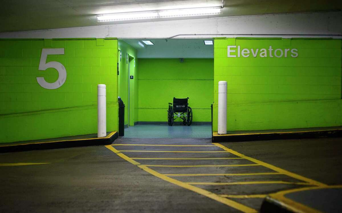 A wheel chair is abandoned outside a parking garage elevator at the Texas Medical Center.