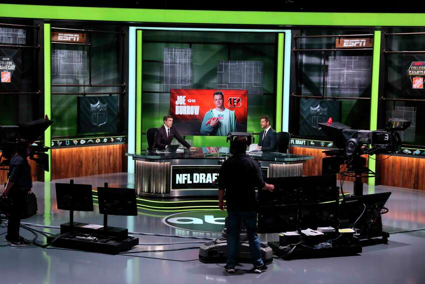 In a photo provided by ESPN Images, ESPN provides coverage of the NFL football draft, Thursday, April 23, 2020, in Bristol, Conn. (Allen Kee/ESPN Images via AP)
