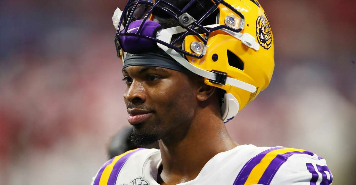 Linebacker K'Lavon Chaisson #18 of the LSU Tigers looks on from the sidelines during the game against the Oklahoma Sooners in the Chick-fil-A Peach Bowl at Mercedes-Benz Stadium on December 28, 2019 in Atlanta, Georgia. (Photo by Gregory Shamus/Getty Images)
