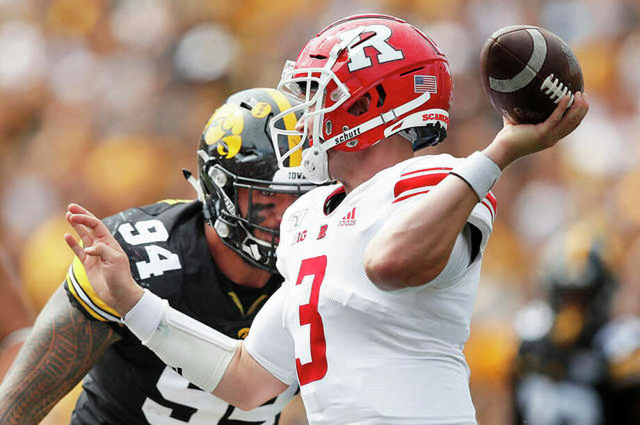 Iowa defensive end A.J. Epenesa, left, pressures Rutgers quarterback McLane Carter, right, during the first half of an NCAA college football game, Saturday, Sept. 7, 2019, in Iowa City.