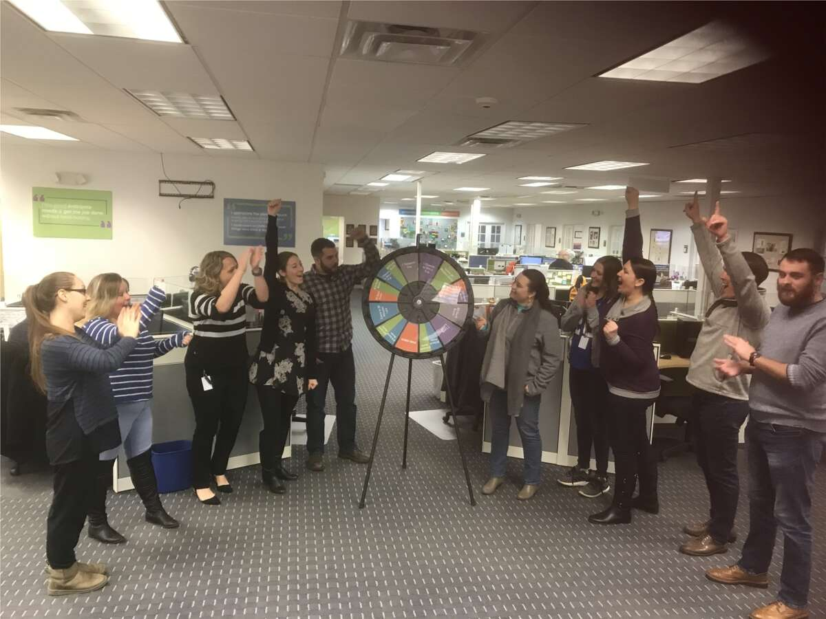 Staff at DWM , a 2020 Times Union Top Workplace, have some office fun spinning a wheel to win prizes.