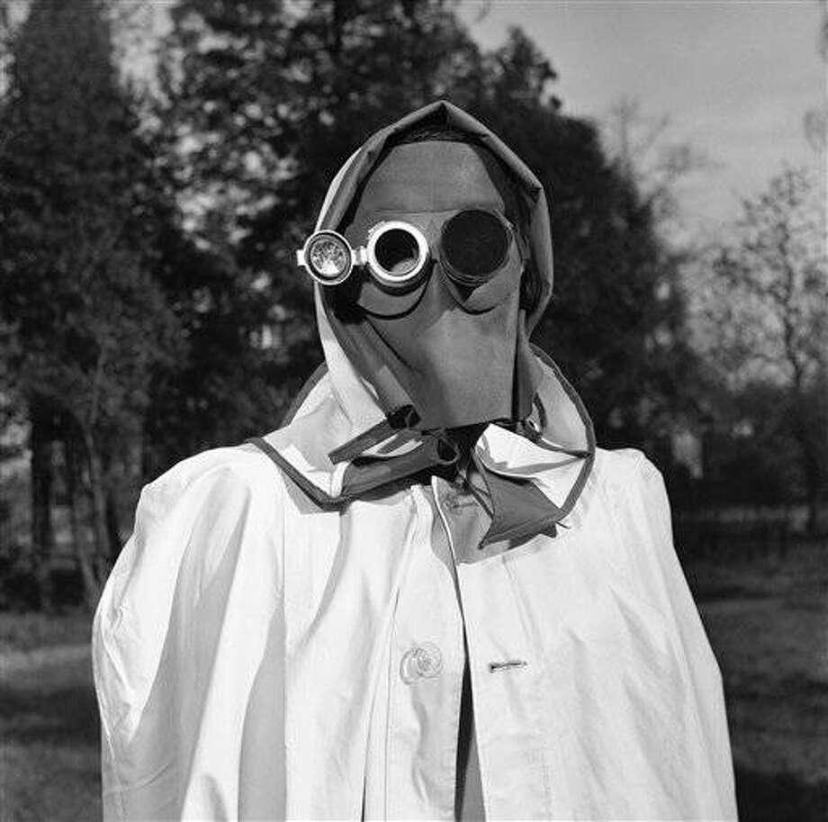 The face mask is recommended by a West German federal civil defense study group as protection against radioactive fallout in Hamburg, Germany, April 24, 1957. The dark glass at right protects the eye from intense light while the mirror, left, enables the wearer to read inside instruments indicating the intensity of radioactivity. (AP Photo/Henry Brueggemann)