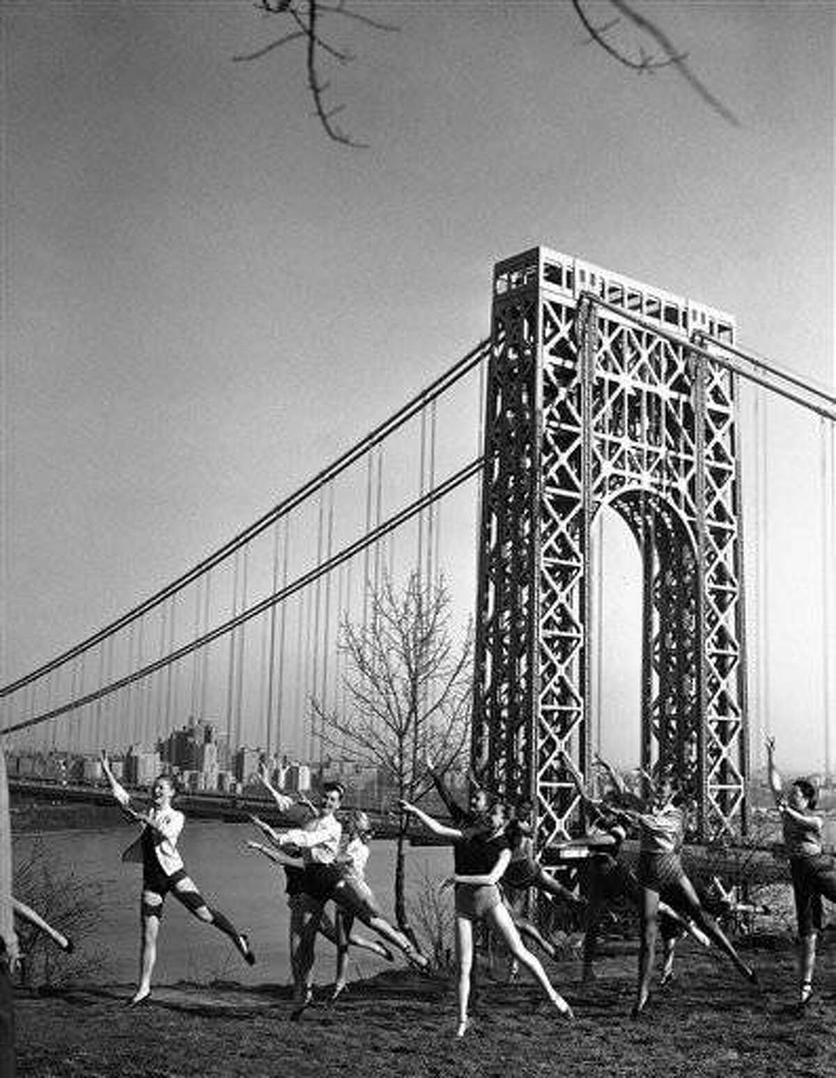After hours of indoor practice, dancers from a New Jersey nightclub come outdoors to carry on their rehearsal in the spring air on the Jersey side of the George Washington Bridge, April 24, 1951. In the background is the bridge and the view of Manhattan looking north up the Hudson River, as they go through their routine on the Palisades Cliffs adjacent to the club, Bill Millers Rendezvous, in preparation for the opening next month. (AP Photo/Robert Kradin)