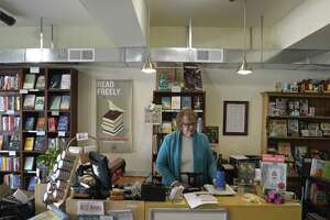 Alice Hutchinson, owner of Byrd's Books, an independent book store in Bethel, at her closed shop Wednesday.