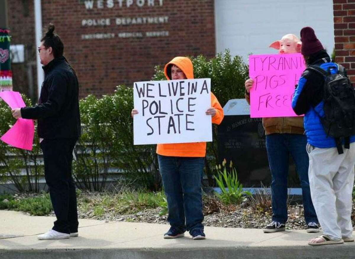 Protestors gather outside the Westport Police Department on Wednesday. The group was protesting the use of drones by the department to surveil residents diagnosed with coronavirus.