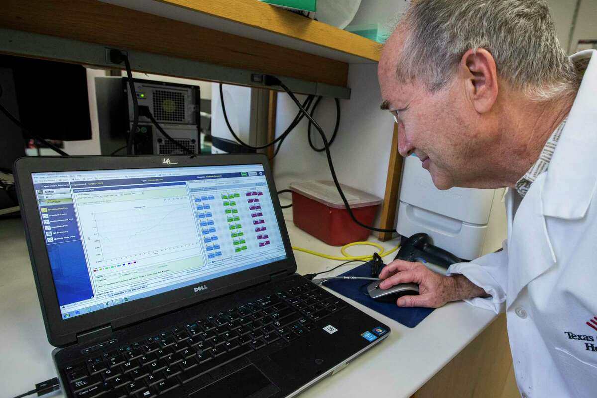 Vasanthi Avadhanula, Ph.D, shows Dr. Pedro Piedra, coronavirus test results in a lab at Baylor College of Medicine in Houston. Piedra's lab developed and validated one of two tests that will be used in a new study that will determine the prevalence of the coronavirus in Houston from whether individuals' blood shows the presence of antibodies to the infection.