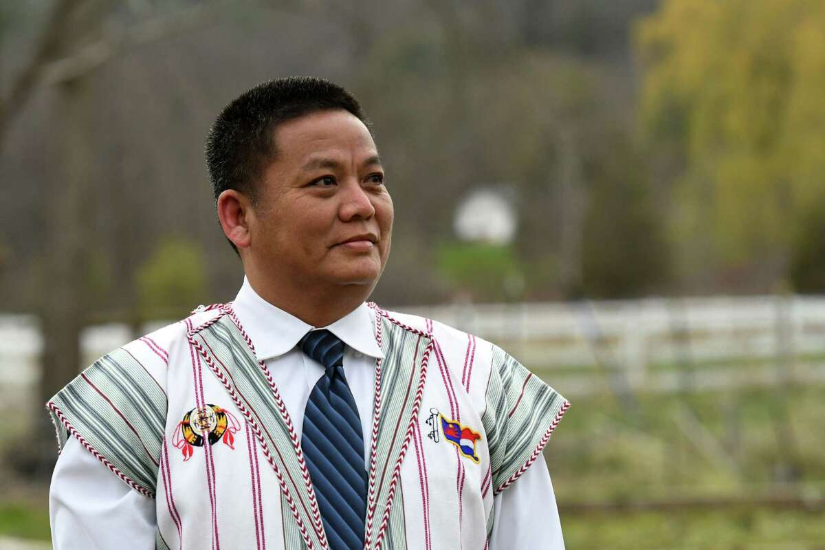 Saw Htoo is pictured outside his house on Thursday, April 23, 2020, in New Scotland, N.Y. Htoo is a pastor in Albany. His wife Hser Lah is an essential worker at Albany Medical Center in patient support. They are both refugees from Myanmar who came to the U.S. over a decade ago. (Will Waldron/Times Union)