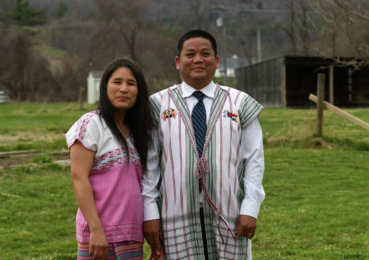 Hser Lah, left, and her husband Saw Htoo are pictured outside their house on Thursday, April 23, 2020, in New Scotland, N.Y. Lah is an essential worker at Albany Medical Center in patient support. Saw Htoo is a pastor in Albany. They are both refugees from Myanmar who came to the U.S. over a decade ago. (Will Waldron/Times Union)