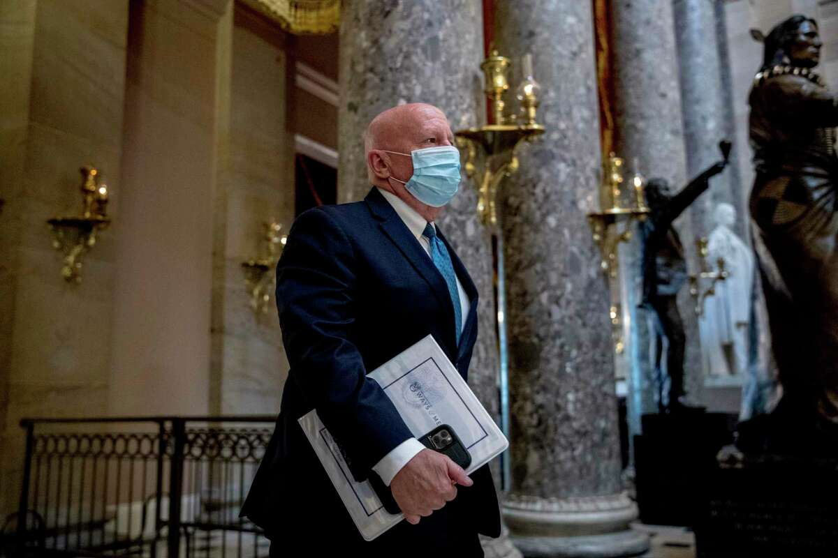Rep. Kevin Brady, R-Texas, walks out of the House Chamber on Capitol Hill, Thursday, April 23, 2020, in Washington. The House is expected to vote on a nearly $500 billion Coronavirus relief bill. (AP Photo/Andrew Harnik)