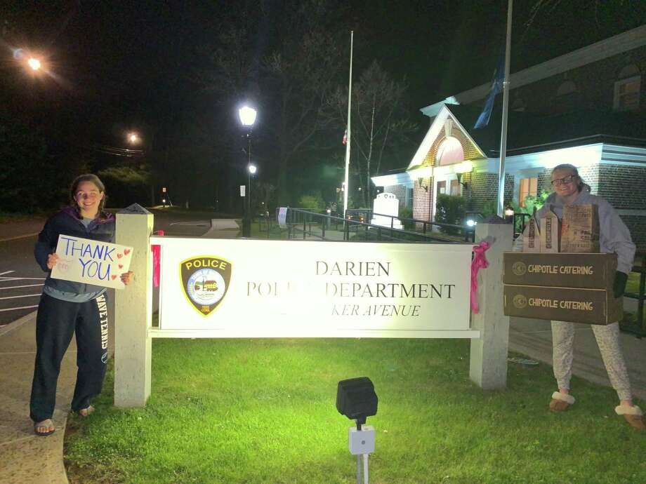The Depot Girls Night Out club treated the minight shift at the Darien Police Department with Chipotle. Carline Homes, left, and Annelise Finn, helped deliver. Photo: Contributed