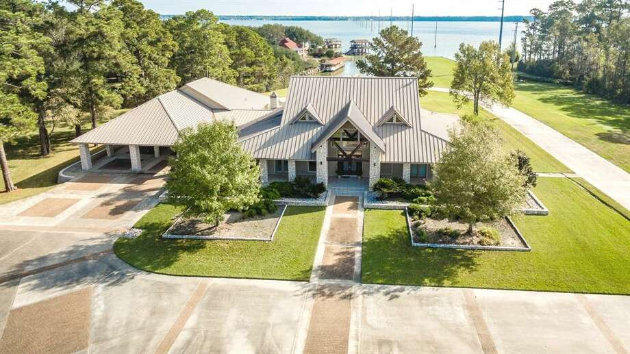 Located at 19502 Atascocita Shores Drive, this nearly $5 million estate offers its own private boat harbor right off of Lake Houston. At 8,159 square feet, the home offers four bedrooms, five full and one half bathrooms, personal gym, five-car garage and six acres of land. Photo: Houston Association Of Realtors
