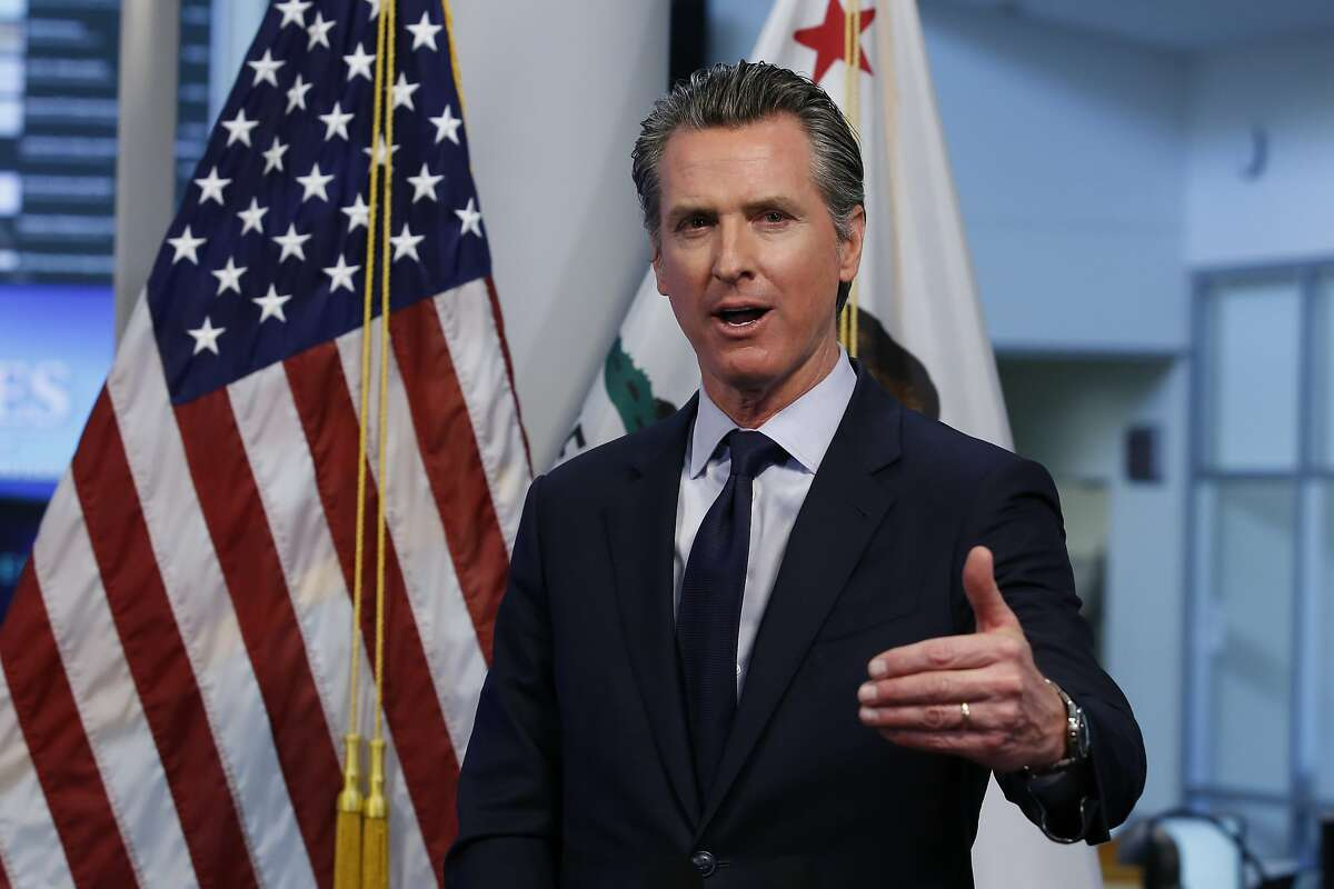 Gov. Gavin Newsom discusses an outline for what it will take to lift coronavirus restrictions during a news conference at the Governor's Office of Emergency Services in Rancho Cordova, Calif., Tuesday, April 14, 2020. Newsom said he won't loosen the state's mandatory stay-at-home order until hospitalizations, particularly those in intensive care units,