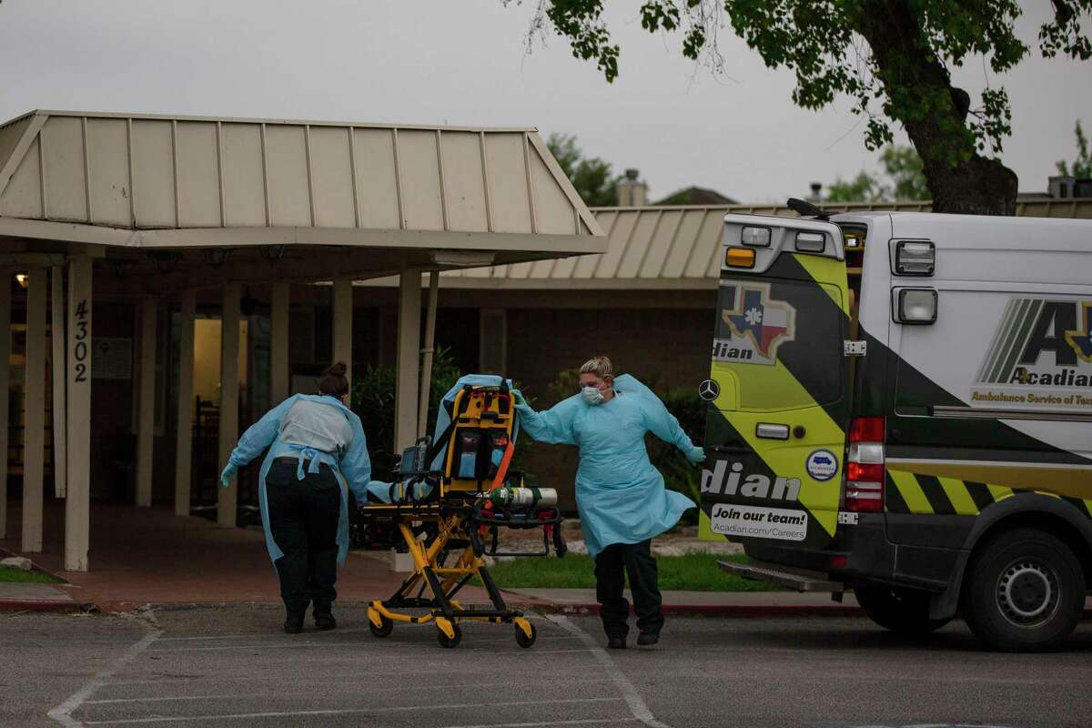 EMS personnel members respond to a call at Southeast Nursing & Rehabilitation Center in San Antonio, Texas, April 2, 2020. It was announced Wednesday that an outbreak of COVID-19 has killed one resident and infected at least 14 others.