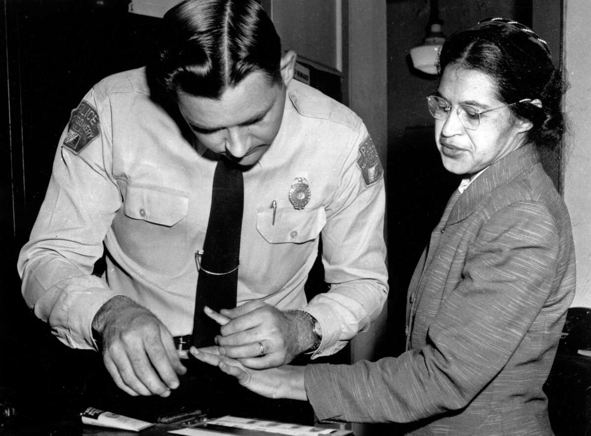 Rosa Parks is fingerprinted by police Lt. D.H. Lackey in Montgomery, Ala., in this Feb. 22, 1956 file photo, two months after refusing to give up her seat on a bus for a white passenger on Dec. 1, 1955. Remember Parks for her civil rights work. Honor her by pushing for greater equality and social justice.