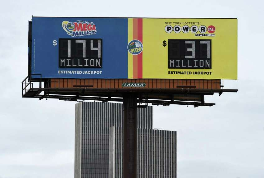 A lottery billboard shows the latest Mega Millions and Powerball jackpots on Friday, April 24, 2020, in Albany, N.Y. With stimulus checks being sent out, anti-gaming activists fear that a significant number of New Yorkers will squander their money and they are calling for a 30-day halt to the lottery. (Will Waldron/Times Union)