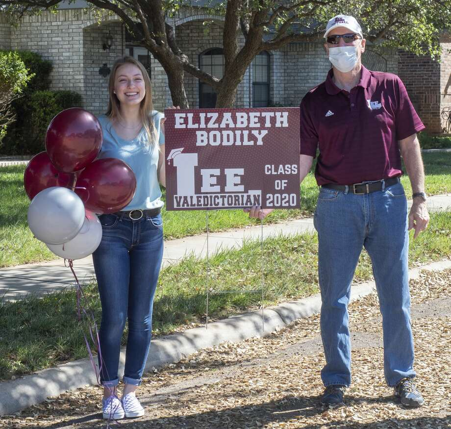 Lee High administrators and counselors caravan through town 04/24/2020 stopping to honor the top 10 seniors of 2020. Principal Stan VanHoozer presents Elizabeth Bodily the #1, valedictorian senior for LHS. Tim Fischer/Reporter-Telegram Photo: Tim Fischer/Midland Reporter-Telegram