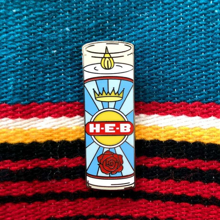 """Name Pinding, the Austin-based design company known for sought-after products like the """"Fiesta Popovich"""" medal, released a limited edition of a pin in honor of H-E-B. The prayer candle first launched in the fall, but is a bestseller, amid the growing appreciation for H-E-B's coronavirus pandemic readiness. Photo: Courtesy, Name Pinding"""