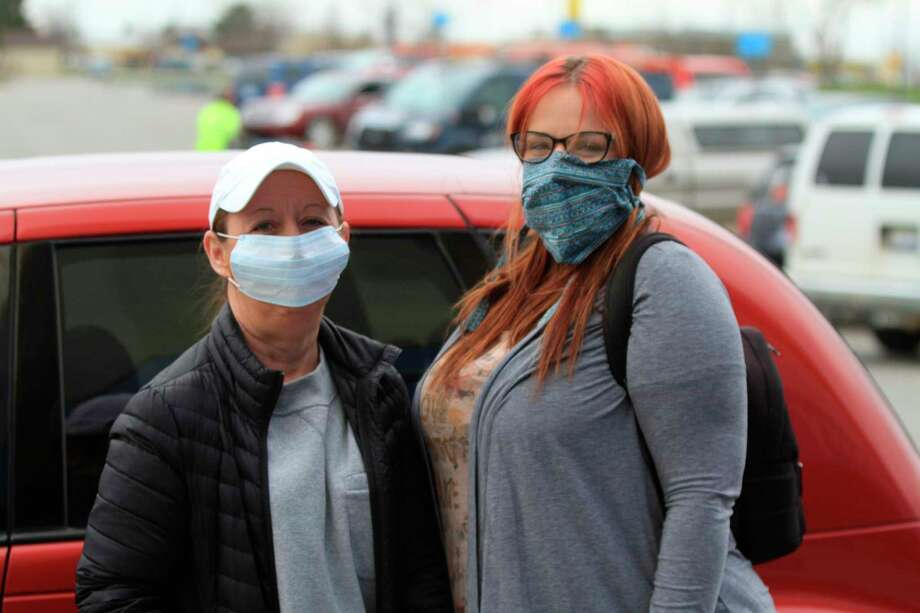 Robin Ales and Tandy Bucholtz wear masks in front of a local grocery store earlier this week. Under Gov. Gretchen Whitmer's extended stay-at-home order, people are now required to wear masks while in public enclosed spaces, as long as they are medically able. (Green Globe Films/For the Tribune)