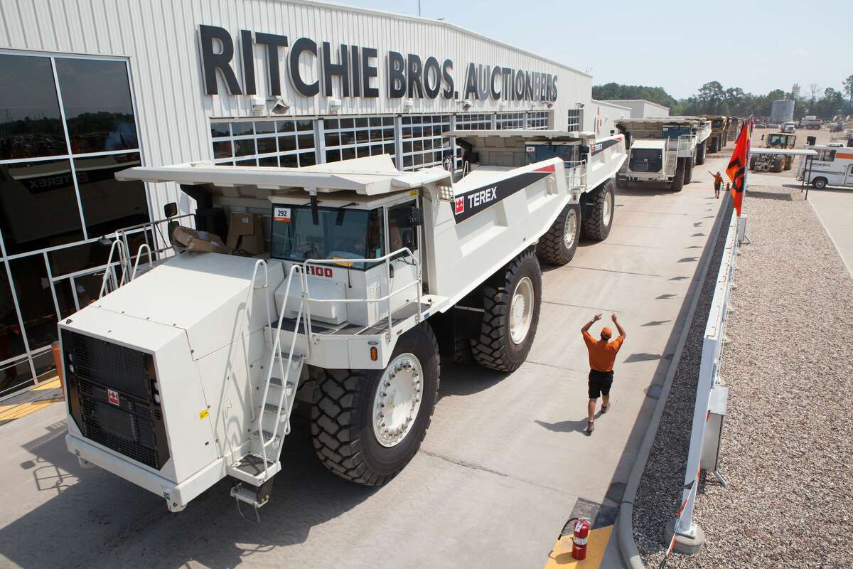 Rock trucks are seen at an auction conducted by Ritchie Bros. The company anticipates more oil- and gas-specific and -related equipment coming to auction amid low oil prices.