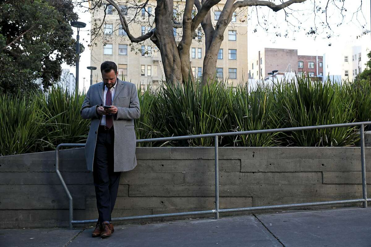 San Francisco District 6 Supervisor Matt Haney checks his phone while standing in Boeddeker Park, located at 246 Eddy Street, in San Francisco, Calif., on Friday, February 7, 2020. Since entering City Hall last year, Haney has quickly emerged as one of the most visible and active supervisors.