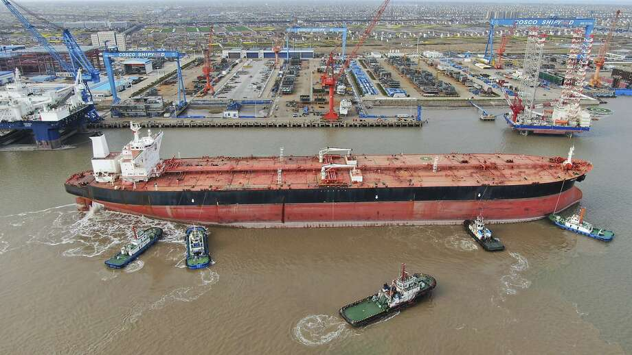 FILE - In this photo taken Monday, March 16, 2020, tugboats push a 300,000-ton very large crude carrier (VLCC) to a shipyard on the Yangtze River for retrofit in Qidong city in east China's Jiangsu province China. Photo: Associated Press
